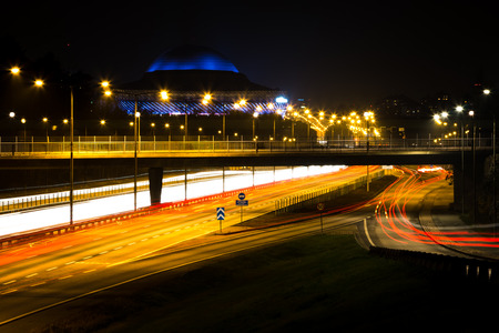 Stockholm, Sweden night time with highway and light trails horizontal Stock Photo