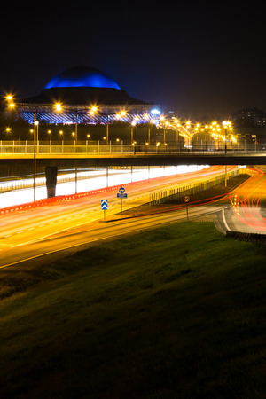 Stockholm, Sweden night time with highway and light trails vertical
