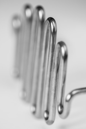 Macro close-up of potato masher with selective focus in black and white photo