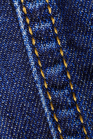 Macro close-up of denim jeans with fabric and seam