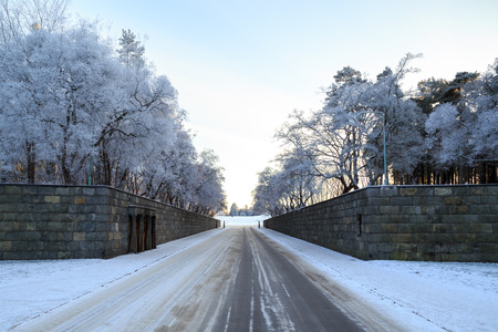 Winter view of entrance to Woodland Cemetery in Stockholm, Sweden