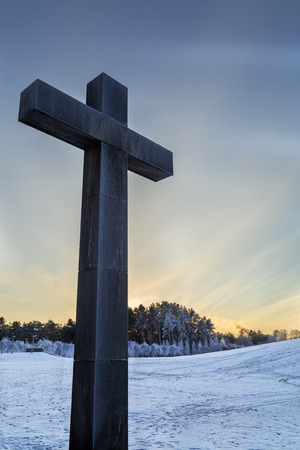 Cross with Woodland cemetery in Stockholm, Sweden in background