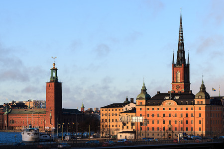 Cityscape view of Stockholm, Sweden with City hall to left and The Riddarholmen Church to the right