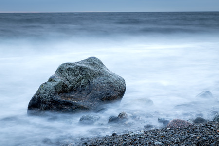 Horizontal dark coastal shoreline with long exposure time Stock Photo