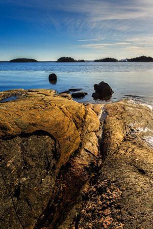 islets: Vertical landscape image from Swedish archipelago with rocks, ocean and islets