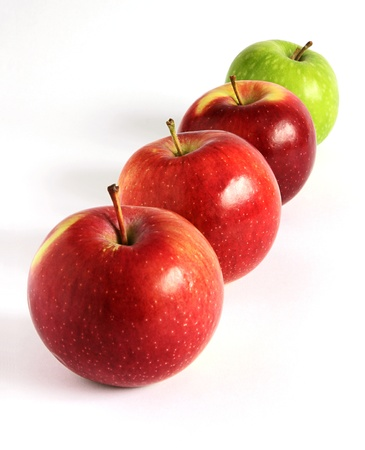 Fresh red and green apples diagonally on a white background Stock Photo - 13717903