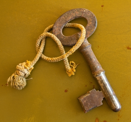 Ancient key on grunge metal background photo
