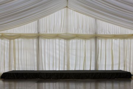 inside of a clear span marquee with a pleated lining