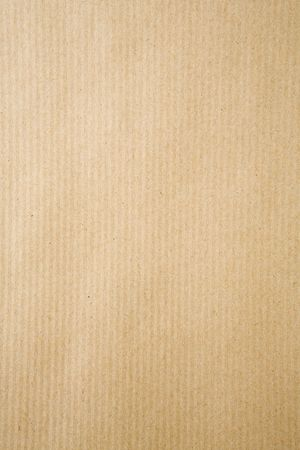 background image filling the frame with strong brown wrapping paper Stock Photo