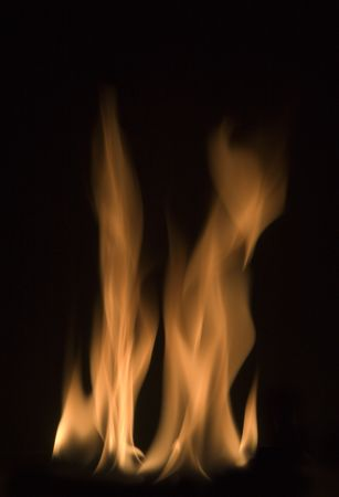 image of red hot fire frozen in time against a black background