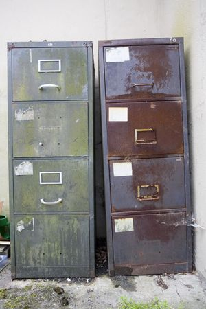 banish: two old filing cabinets going rusty