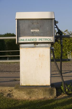 banish: Old traditional petrol pump rusting away Stock Photo