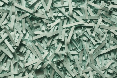 close up detail image of sheredded green paper photo