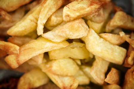 bought: look down at chips bought from a chip shop in england