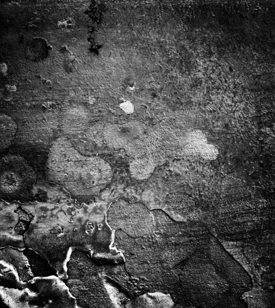 close up detail black and white image of the surface of metal photo