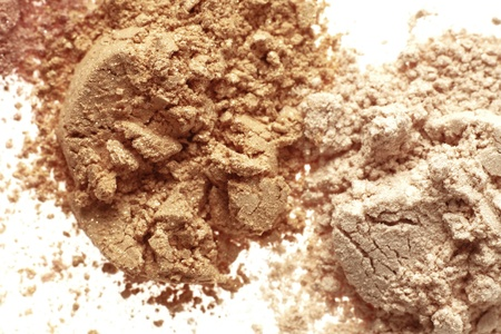 close up detail shot of a  powder maker up, isolated over white  Stock Photo