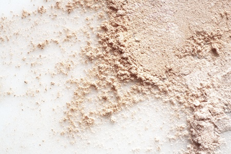 close up detail shot of a  powder maker up, isolated over white  photo