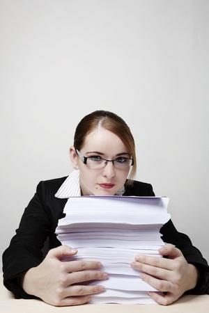 woam at her desk looking at all the paper work she has to do photo