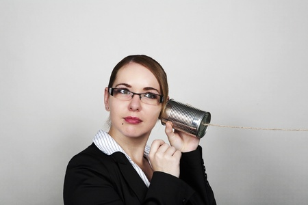 business womam making a call on a tin can photo