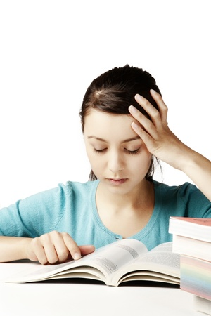 young good looking girl working hard over text books Stock Photo - 12189515