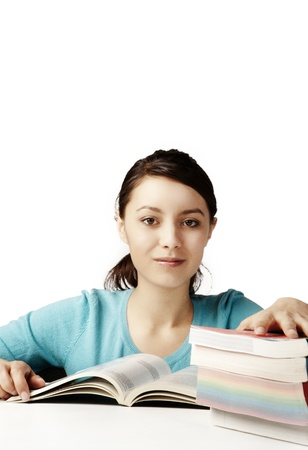 young good looking girl working hard over text books Stock Photo - 12190618