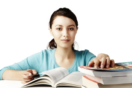 young good looking girl working hard over text books Stock Photo - 12189511