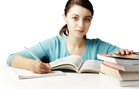young good looking girl working hard over text books Stock Photo - 12189509