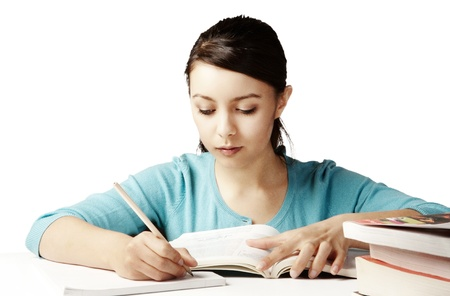 young good looking girl working hard over text books Stock Photo - 12190639