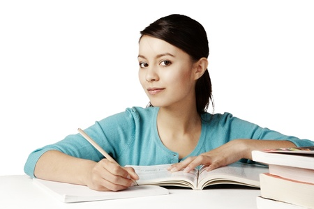 young good looking girl working hard over text books Stock Photo - 12190640