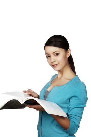 young woman looking at a textbook Stock Photo - 12190630