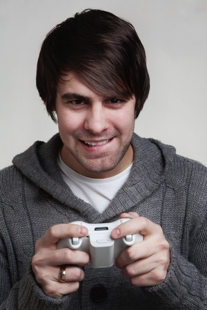 young guy playing a video game photo