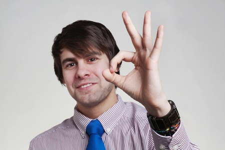 business looking man in a shirt and tie doing hand gestures, ok Stock Photo - 12506673