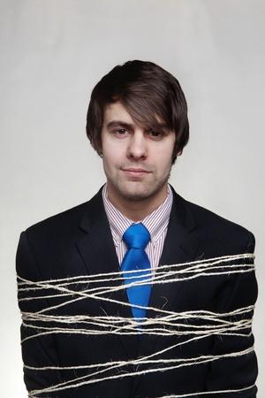 immobile: empresario de atar con una cuerda alrededor de su cuerpo