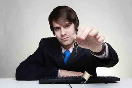 businessman with a padlock on his keyboard photo