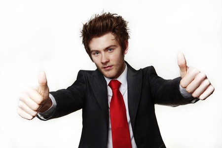 young businessman very happy with his thumbs up Stock Photo - 12503536