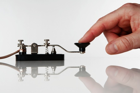 morse code key on a white background with someone sending a message Standard-Bild