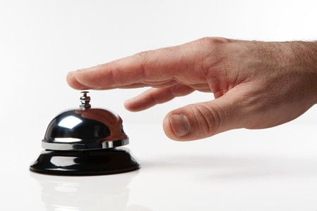 bellman: someones hand pressing a service bell what could they want Stock Photo