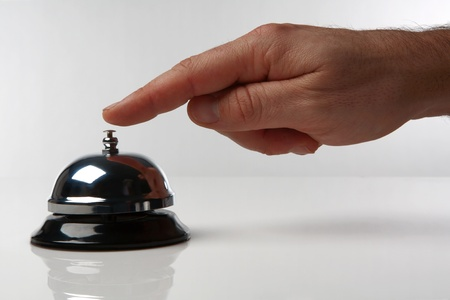 someone's hand pressing a service bell what could they want Stock Photo - 12861256