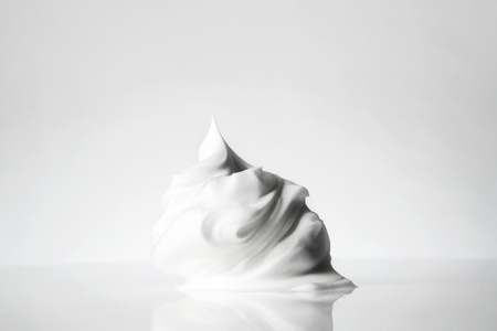 close up detail shot of shaving cream on a white background Stock Photo