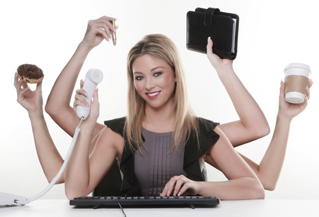 multi tasking: woman with six arms multitasking her work and daily life Stock Photo