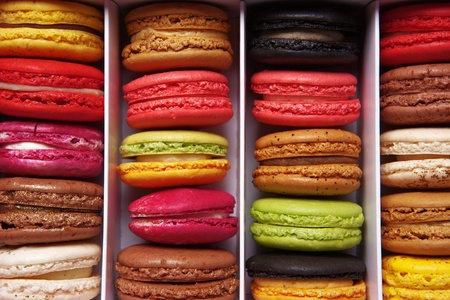 shot taken from above of a box full of macaron or French macaroon, colourful meringue-based almond treats photo