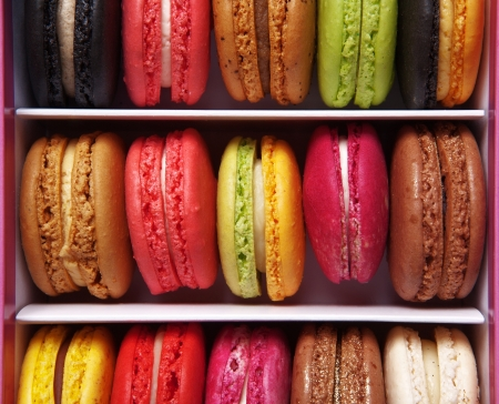 shot taken from above of a box full of macaron or French macaroon, colourful meringue-based almond treats Stock Photo - 13224720