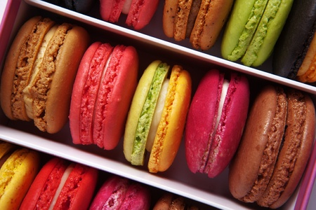 shot taken from above of a box full of macaron or French macaroon, colourful meringue-based almond treats Stock Photo - 13224726