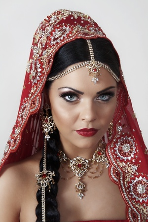 veil: indian women dressed in red