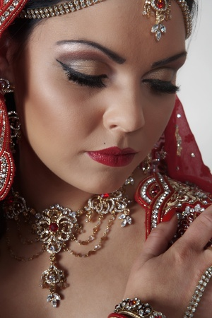indian women dressed in red  photo