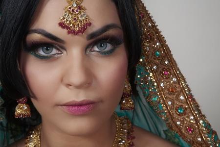 attractive indian women close up portrait shot in the studio photo