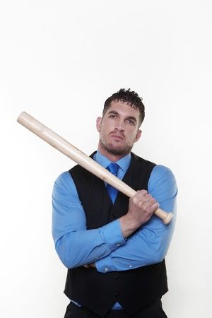 Handsome business man holding a baseball bat looking a bit hard Stock Photo - 13570007