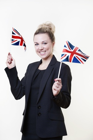 woman waving a british flag about in the air photo