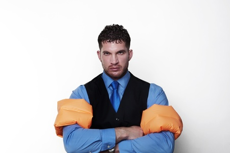 arm bands: handsome business type man wearing rubber arm bands looking at the camera Stock Photo