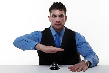 call bell: businessman sitting at a desk with a call bell infront of him
